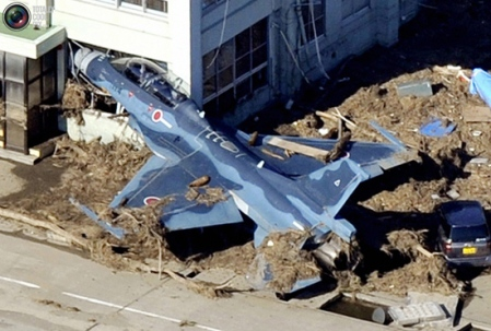 military aircraft damage after Japan tsunami