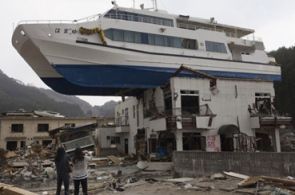 boat on top of building after Japan tsunami